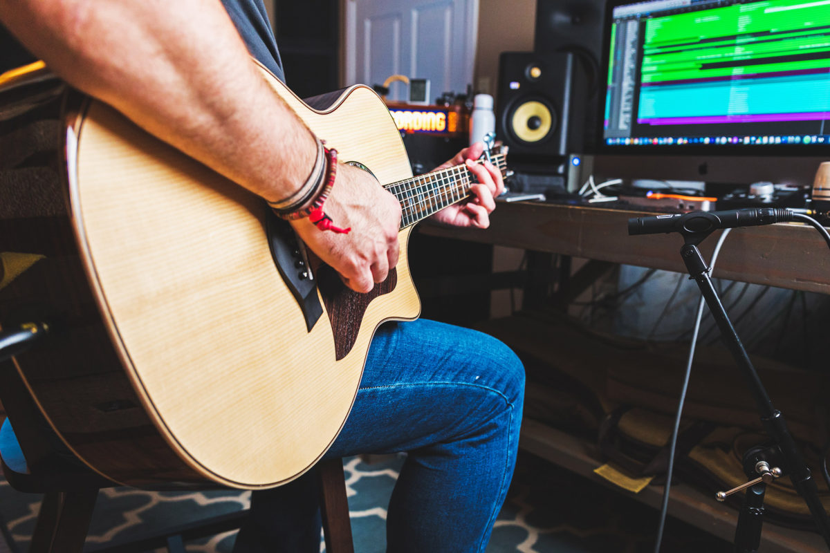 acoustic guitar with recording microphone and equipment