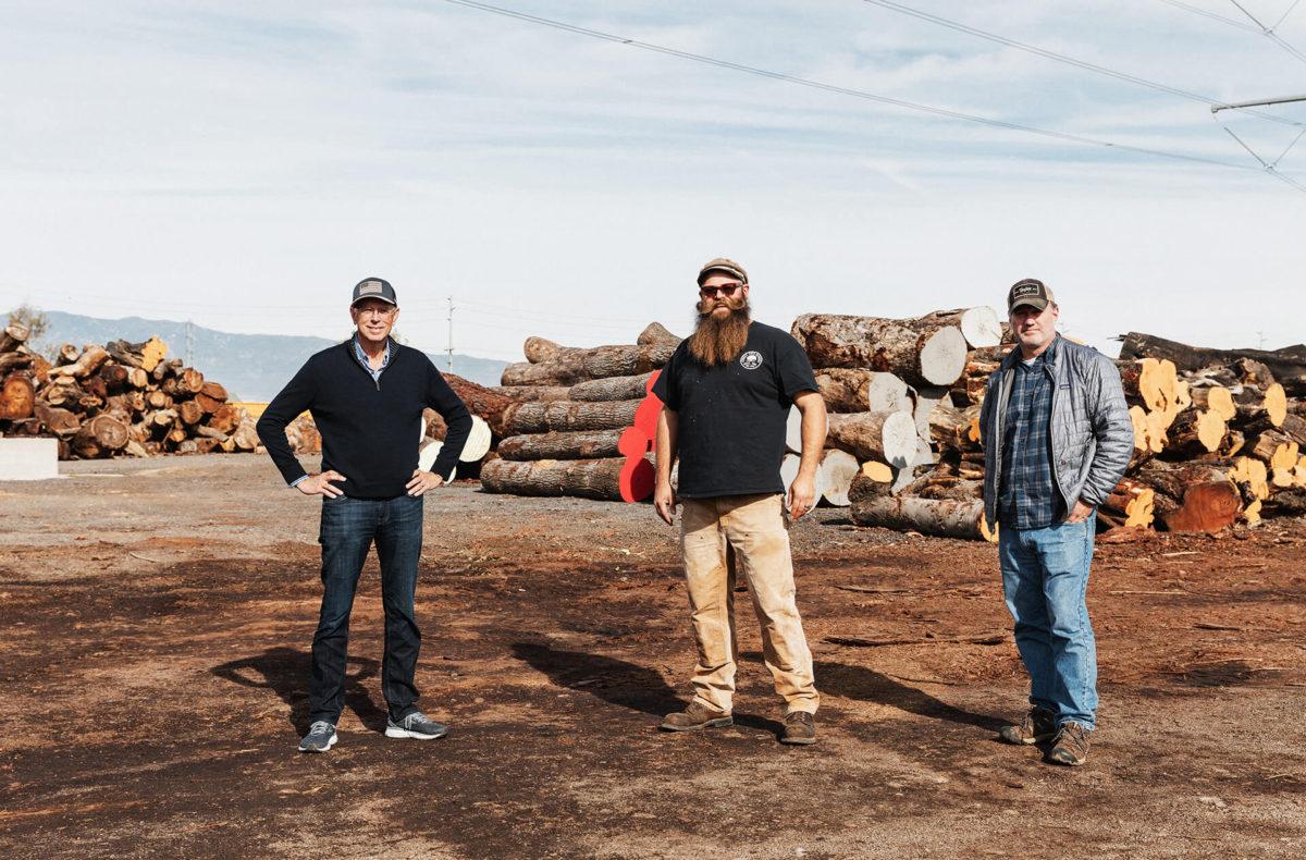 Taylor Guitars staff at a lumber yard