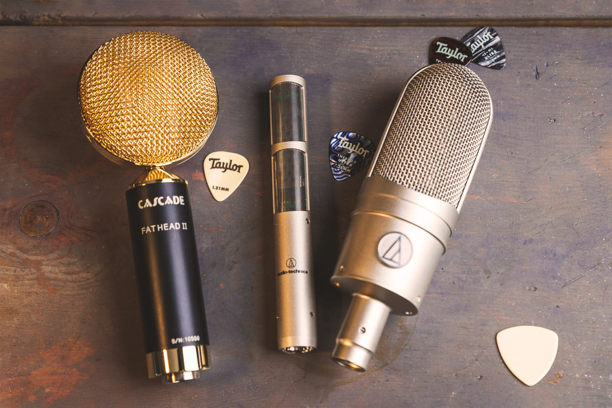 trio of ribbon microphones on wood surface