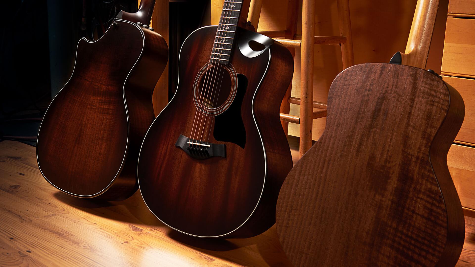 three Taylor acoustic guitars