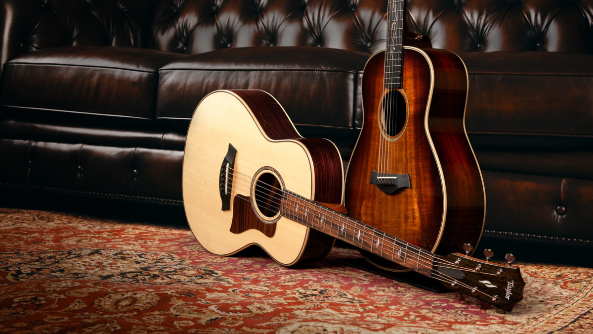 two Taylor GT acoustic guitars - one natural finish and one sunburst finish