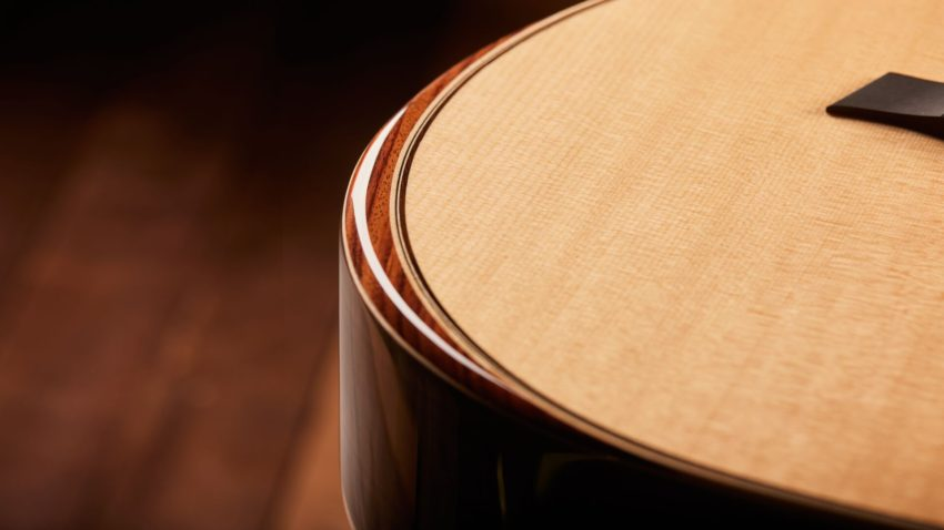 photo of Taylor 800 series acoustic guitar close-up on armrest feature
