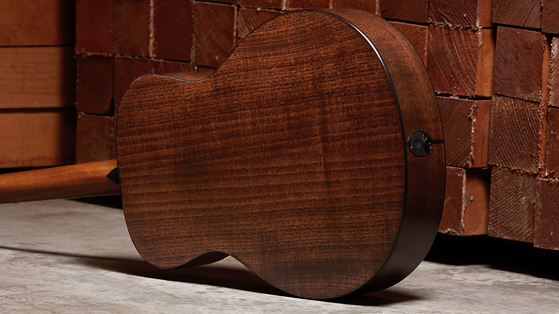 taylor acoustic guitar with back facing camera to show grain of wood